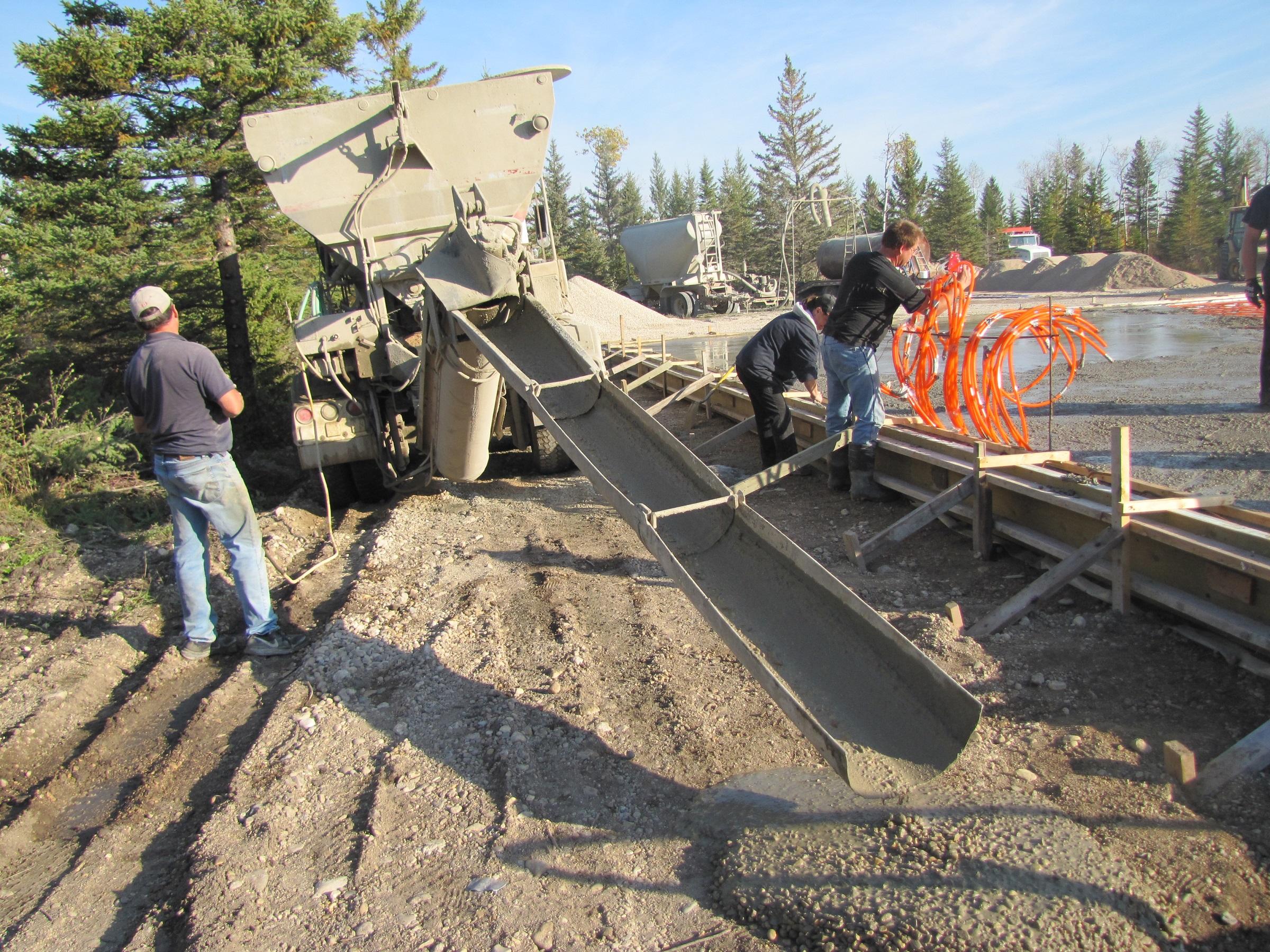 pouring concrete on job site